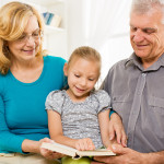 Grandparents reading with granddaughter in Orange County, CA
